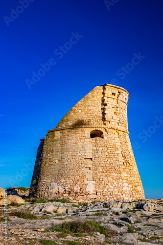 fototapeta na ścianę The ancient watch tower of Porto Miggiano, built on the cliffs overlooking the sea. Bleak and rocky landscape with a splendid view of the sea. Santa Cesarea Terme, Puglia, Salento, Italy.