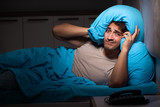 Young handsome man suffering from insomnia in bed - 244395430