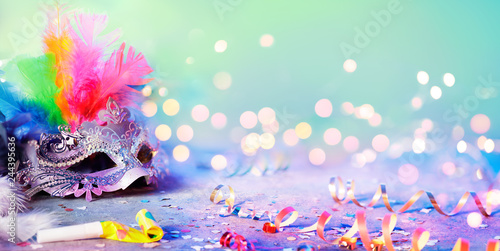 Carnival Mask With Blurred Streamer, Party Confetti And Bokeh