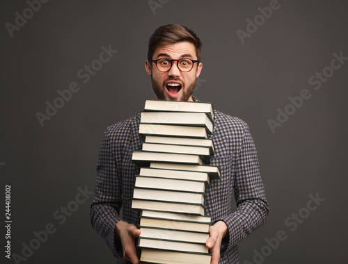 Foto Murales Student with stack of books screaming