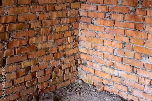 .Brick corner of an old abandoned unfinished building - 244417800