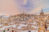 panoramic view of typical stones Sassi di Matera and church of Matera 2019 under blue sky with clouds and snow on the house, concept of travel and christmas holiday ,capital of europe culture 2019 - 244421604
