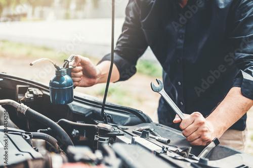 fototapeta na ścianę Auto mechanic working in garage Technician Hands of car mechanic working in auto repair Service and Maintenance car check.