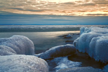 Sunset over Beach in Winter and snow © Like