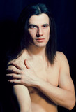 handsome young man with long hair naked torso on black background smiling, lifestyle people concept - 244440887