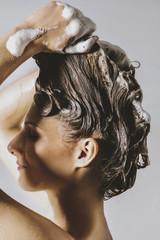 Woman washing hair - hair care