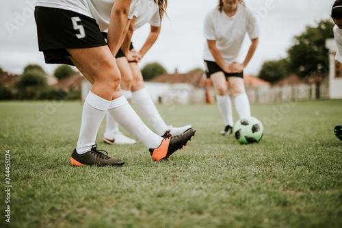 Leinwandbild Motiv Female soccer team players stretching pre game