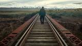 Man alone walking away on the train rails railroad - 244456487