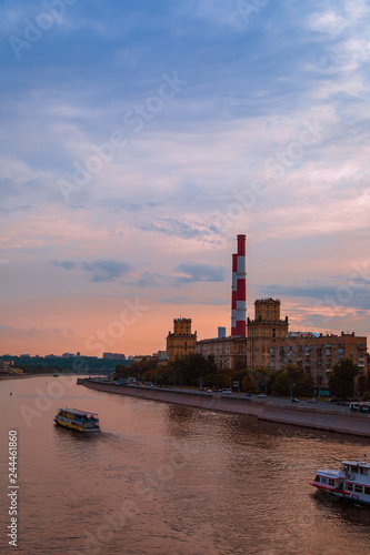 Beautiful night Moscow veiw under sunset blue sky near the river