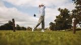 Professional golfer taking shot