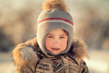crying small boy in winter hat - 244483831