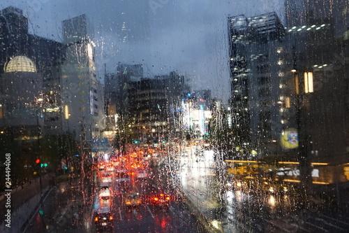 fototapeta na ścianę Rainy evening in the city. Raindrops on glass