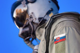 Air force pilot flight suit uniform with Slovakia flag patch. Military jet aircraft pilot