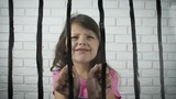 The child is behind bars. - 244504621