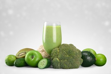 Green vegetable smoothies in glasses on wooden table