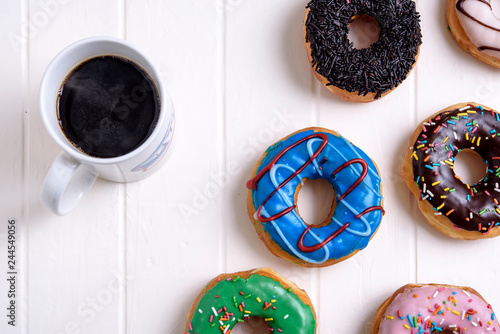 Colorful Donuts with Coffee in White Background