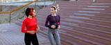 Young women running in urban area - 244558453