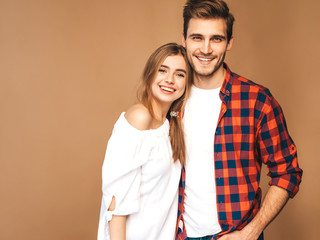 Smiling Beautiful Girl and her Handsome Boyfriend laughing.Happy Cheerful Family.Valentine's Day. Posing on beige wall. Hugging © halayalex