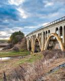 Fototapeta Fototapety pomosty - Old concrete trestle style bridge in the Palouse area of Washington © William