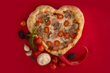 Pizza heart shaped on red