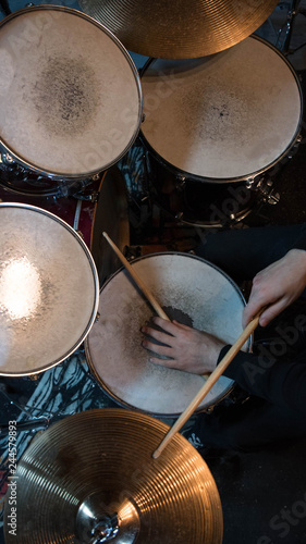 Professional drum set closeup. Drummer with drumsticks playing drums and cymbals, on the live music rock concert or in recording studio    - 244579893