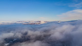 Aerial landscape - Lago-Naki, clouds under mountains