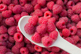 Raspberries. Eat berries with a spoon. Close-up, top view.