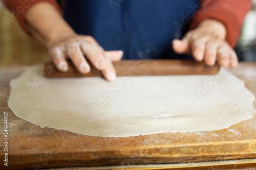 Sticker man kneading dough hand close-up