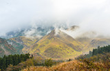 Mountain with morning mist is seen from Yufuin town, Japan