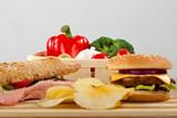 Sandwich, cheeseburger, salad and chips