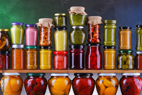 Leinwanddruck Bild Jars with variety of pickled vegetables and fruits
