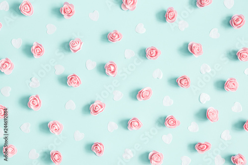 Flowers composition. Pink rose flowers on pastel blue background. Valentines day, mothers day, womens day concept. Flat lay, top view - 244692884
