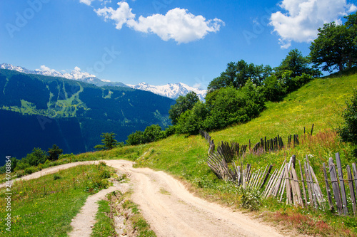 Georgian nature landscape. Summer mountain landscape in Svaneti with road to village
