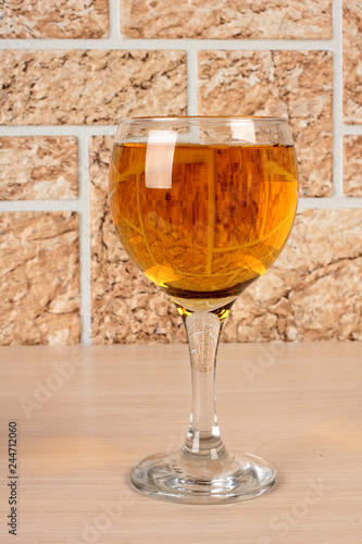 Wine bottle and glass on brick wall background - 244712060