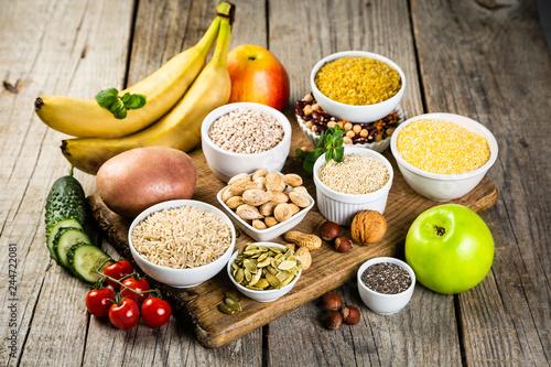 Leinwandbild Motiv Selection of good carbohydrates sources - vegetables, fruits, grains, legumes, nuts and seeds. Healthy vegan diet