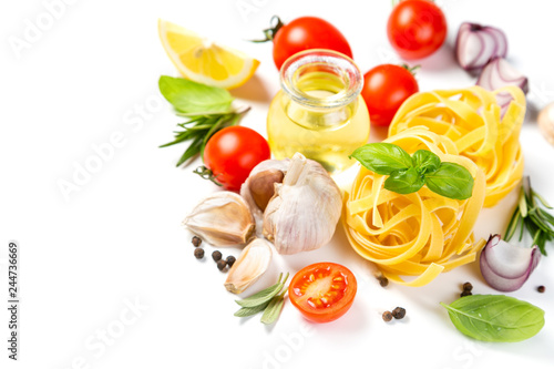 Fridge magnet Italian cuisine concept - raw pasta and ingredients. Healthy vegetarian diet, isolated on white