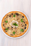 mushroom pizza on wooden background top view