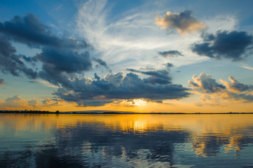 sunset sky with clouds above lake, tourist attraction Nong Han lake at Sakon Nakhon province in thailand