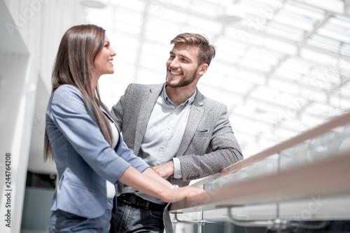 Leinwandbild Motiv business couple talking, standing in the new office