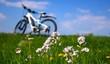Leinwandbild Motiv mit dem e bike in den frühling