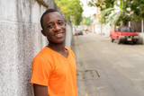 Young happy black African man smiling and looking at camera - 244773694