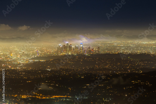 Foggy night aerial cityscape skyline view of urban downtown Los Angeles buildings in Southern California.