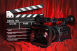 Cinema concept. Movie camera with clapperboard on the red fabric, 3D rendering