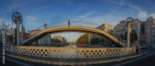Paris, France - 11 03 2018: Canal Lourcq. The lift bridge of Flanders at sunset - 244822679