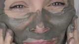 Happy woman in a cosmetic mask. - 244830042