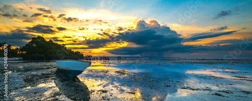 Wooden boat with sunset background - 244840870