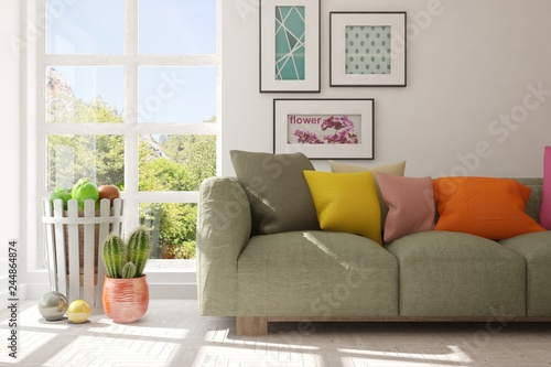 Leinwandbild Motiv White stylish minimalist room with sofa and smmer landscape in window. Scandinavian interior design. 3D illustration
