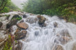 The spring floods on the river Dzembronya, which in the Ukrainian Carpathians, form small waterfalls.