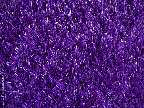 beautiful artificial fur rough texture purple color, charming colorful texture glowing background for party decoration board, shiny violet color of artificial grass mat, close up purple carpet - 244878400