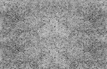 surface de rue pavée, mosaïque vitrail avec des tesselles noires et blanches